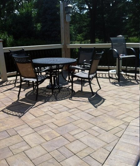 outdoor seating area with stone patio